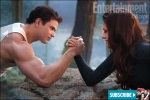 Emmett (Kellan Lutz) challenges newborn vampire Bella (Kristen Stewart) to a friendly arm wrestling match
