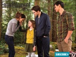 Bella (Kristen Stewart) has a touching moment with Renesmee (Mackenzie Foy) as Edward (Robert Pattinson) and Jacob (Taylor Lautner) look on